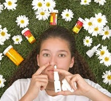 girl on grass with medicines for seasonal allergies