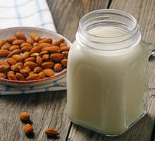 almonds and almond milk on table as part of dairy-free diet