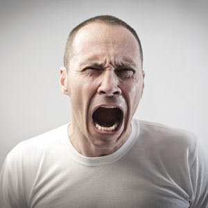 man screaming in pain or anger