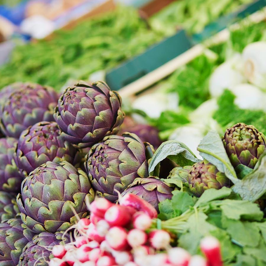 Fresh organic artichokes at a farmers market, ingredients for green Mediterranean diet