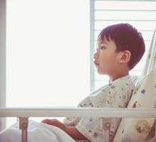 asian child admitted at modern and comfortable equipped hospital room.