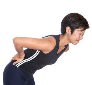 woman with lower back pain, sore back
