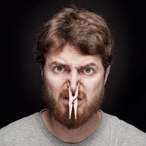 man with a clothespin on his nose