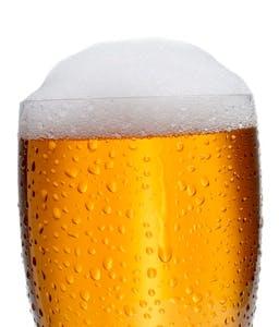a glass of foamy beer
