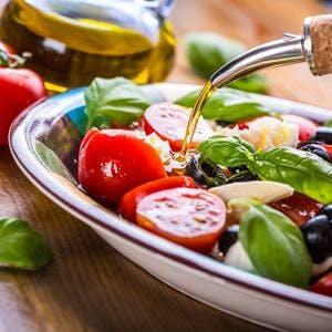 Caprese. Caprese salad. Italian salad. Mediterranean salad. Italian cuisine. Mediterranean cuisine. Tomato mozzarella basil leaves black olives and olive oil. Recipe – Ingredients