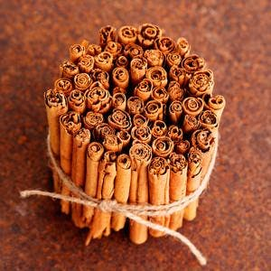 Bunch of ceylon cinnamon on brown – herbs and spices