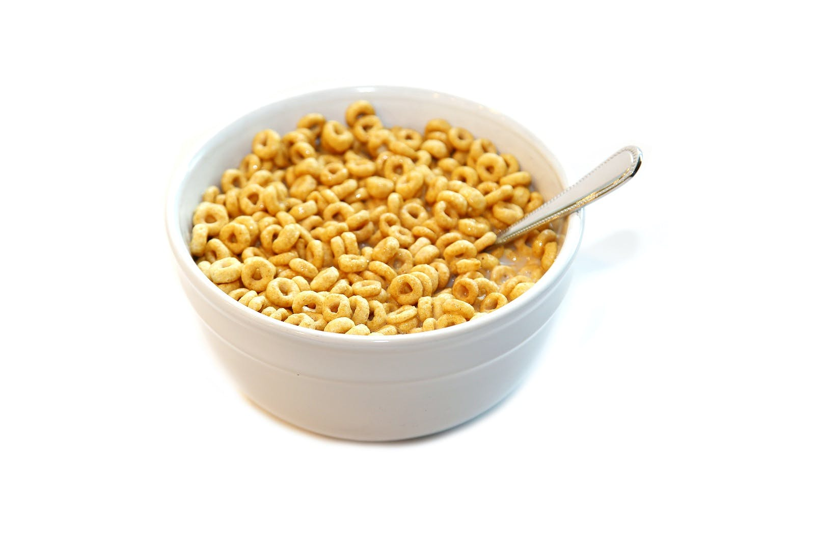 Cheerios. Cereal in a bowl of milk. Breakfast food. Isolated on white. Room for text.