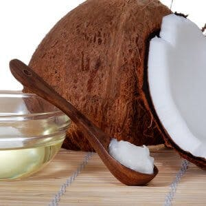 a coconut and coconut oil on a spoon