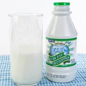 Bottle and glass of buttermilk