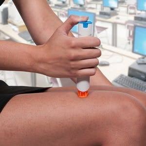 Woman using an EpiPen Epinephrine injector into her leg