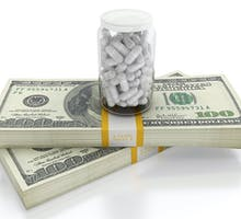 hundred dollar bills with pills