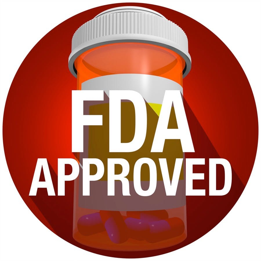 FDA Approved words on an orange pill or medicine bottle with long shadow