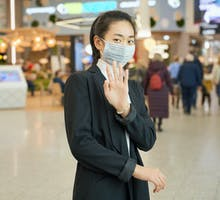 woman wearing facemask in public space