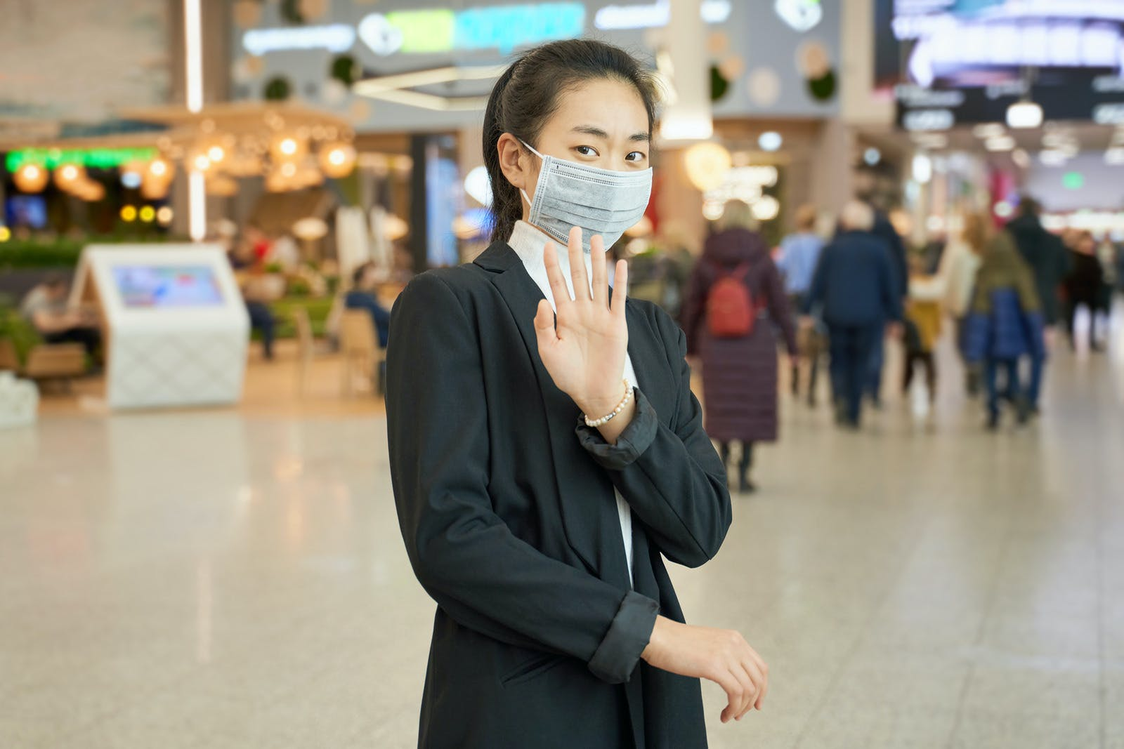 Female wears medical mask to protect against virus