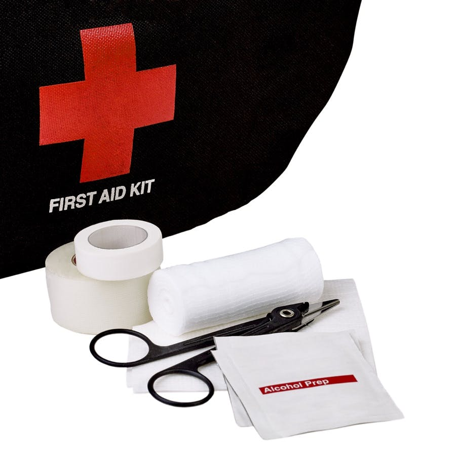 First Aid Kit bag with White gauze bandage roll and pad with alcohol prep wipe medical scissors and medical tape isolated on white