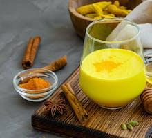 Golden milk containing turmeric for hip bursitis pain