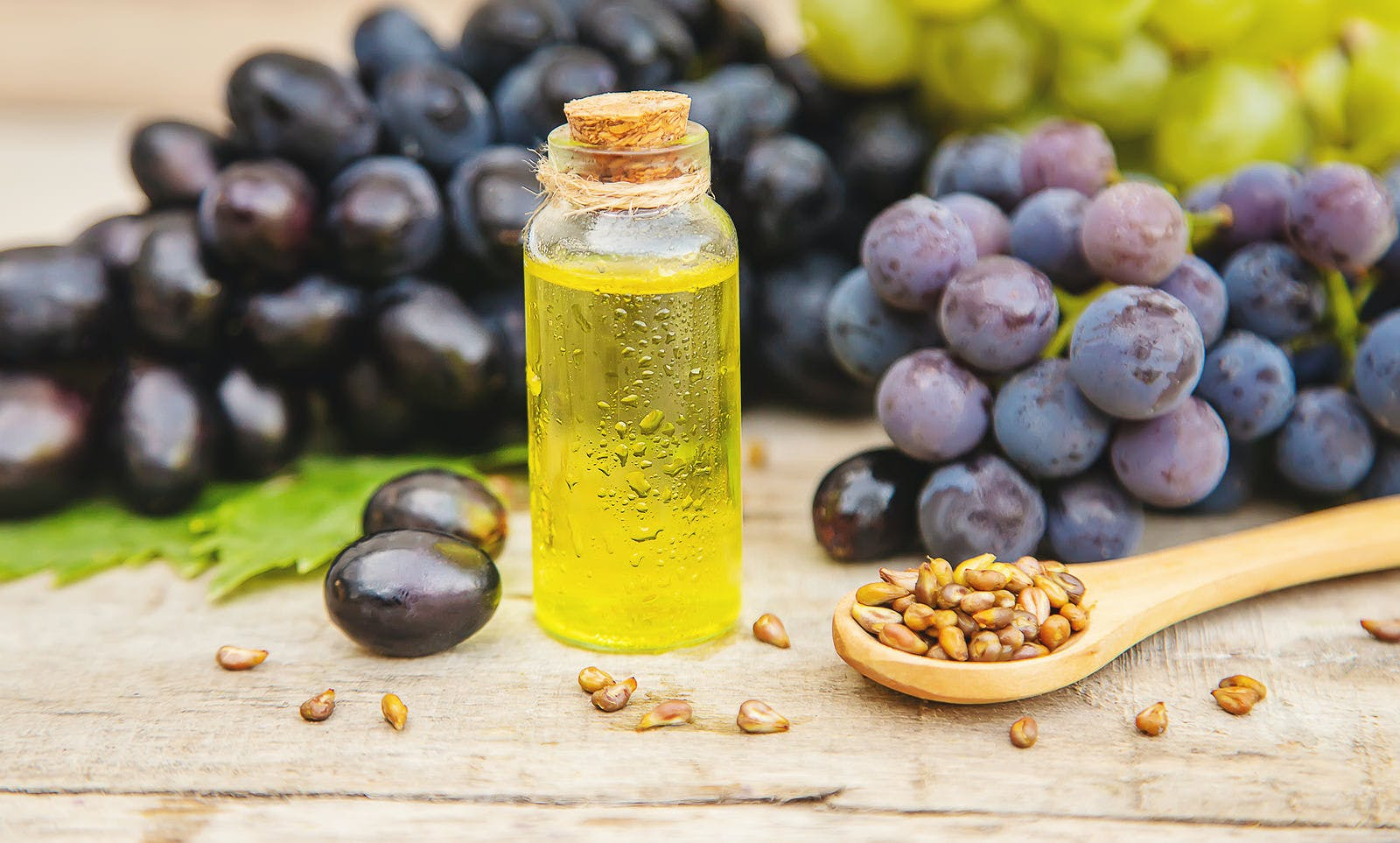 Grape seed oil in a small bottle. Selective focus. nature.