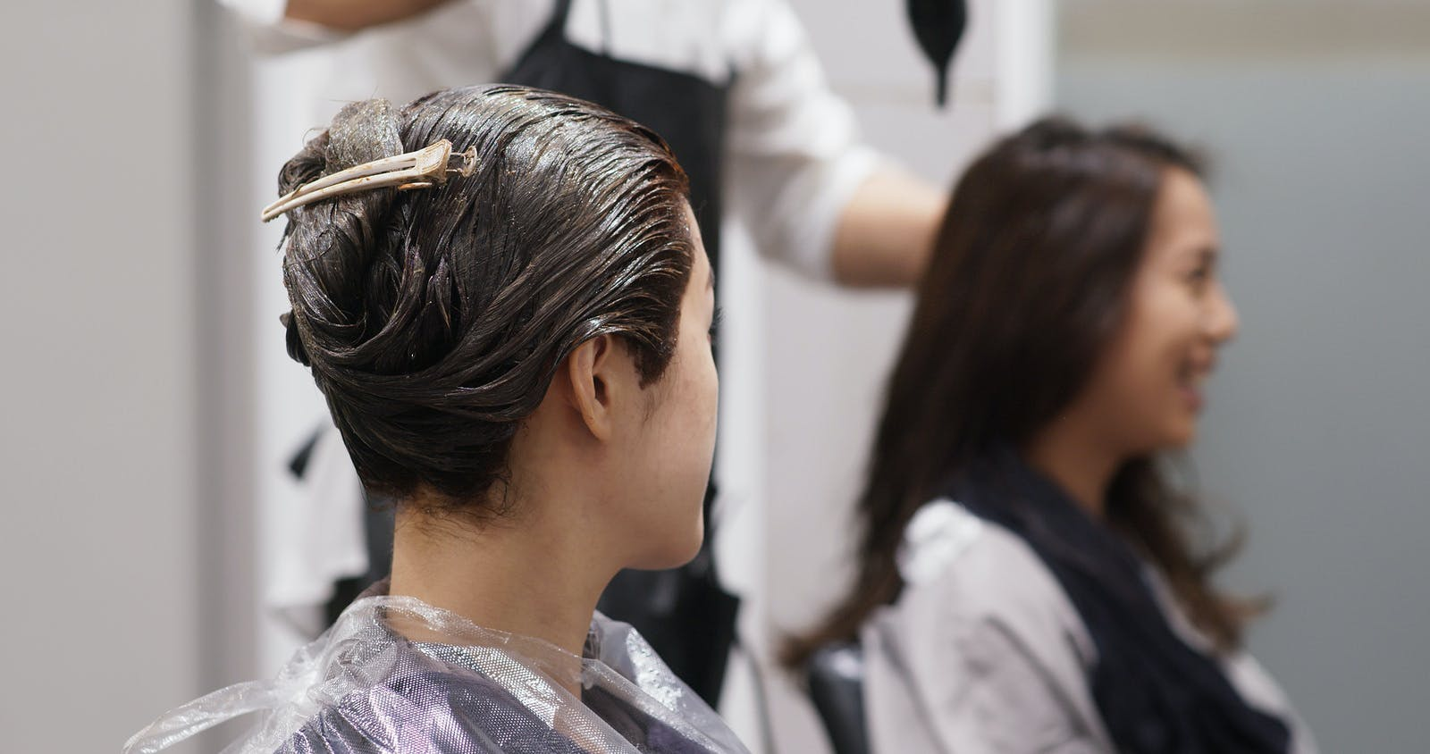 two women wait for hair dyes in salon