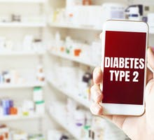 smart phone reads Diabetes type 2 in front of pharmacy shelves with pills responsible for the diabetes epidemic