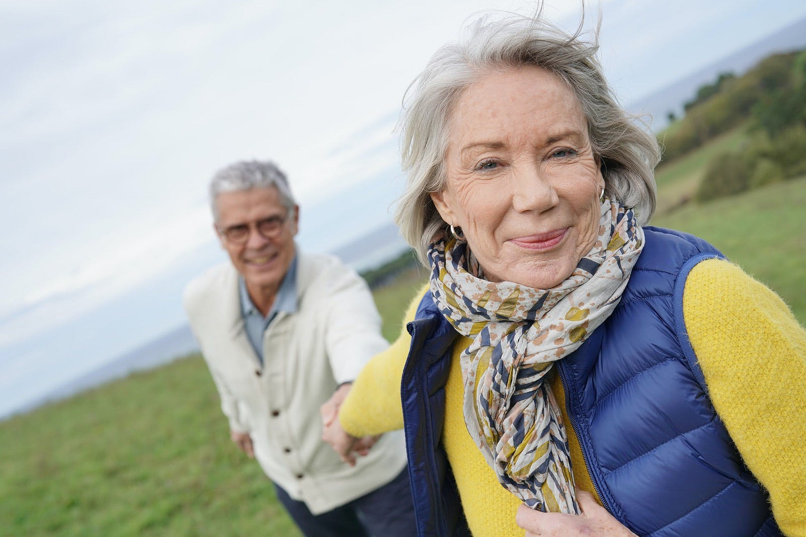 Older woman leads man on walk for light physical activity