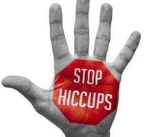 Stop Hiccups - Red Sign Painted on an Open Hand Raised