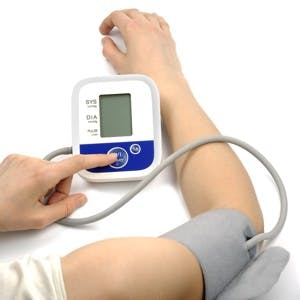 Female hands with blood-pressure meter
