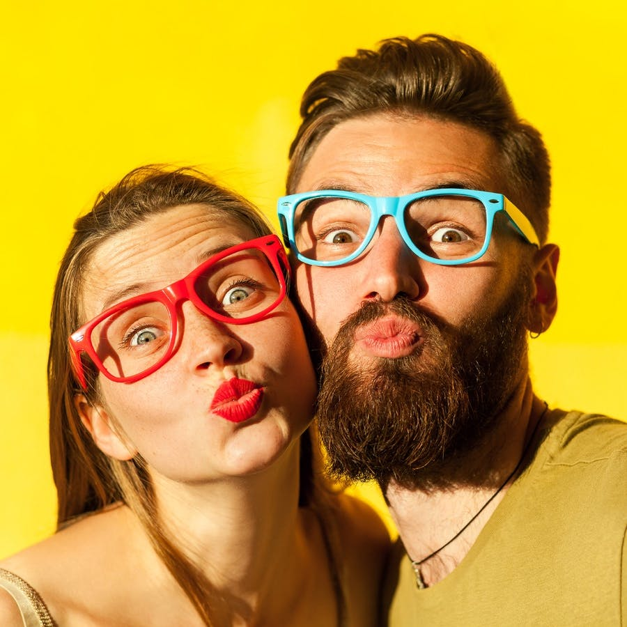 woman and bearded man send air kisses on valentines day