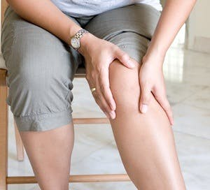 woman with knee and joint pain