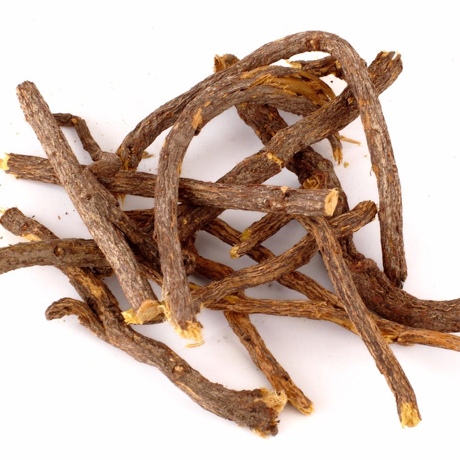 Raw liquorice roots isolated at white background