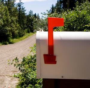 a mailbox on a country road on a sunny day