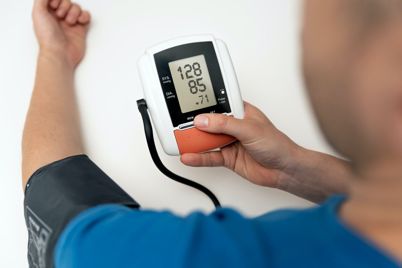 Man check blood pressure. Self care heart rate monitoring with digital pressure gauge.