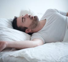 man sleeping with nighttime congestion