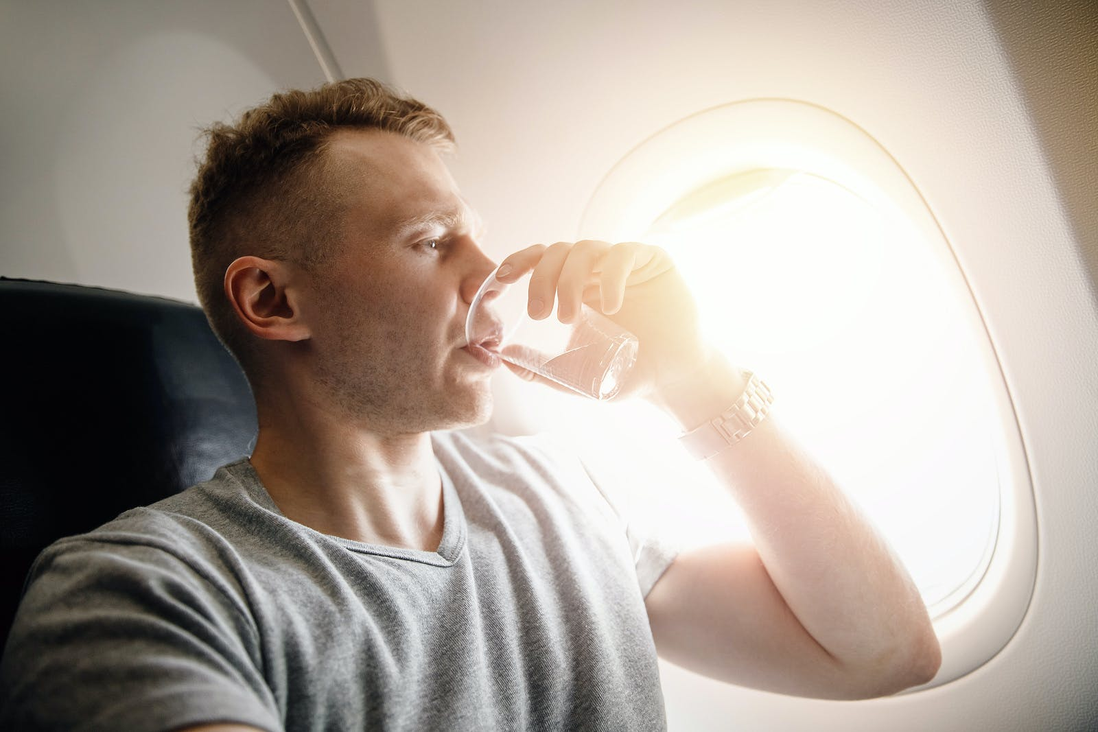 Concept aerophobia. Afraid of fear flying on an airplane and at height. drink water.