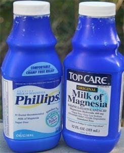 two bottles of Milk of Magnesia (MoM) laxative