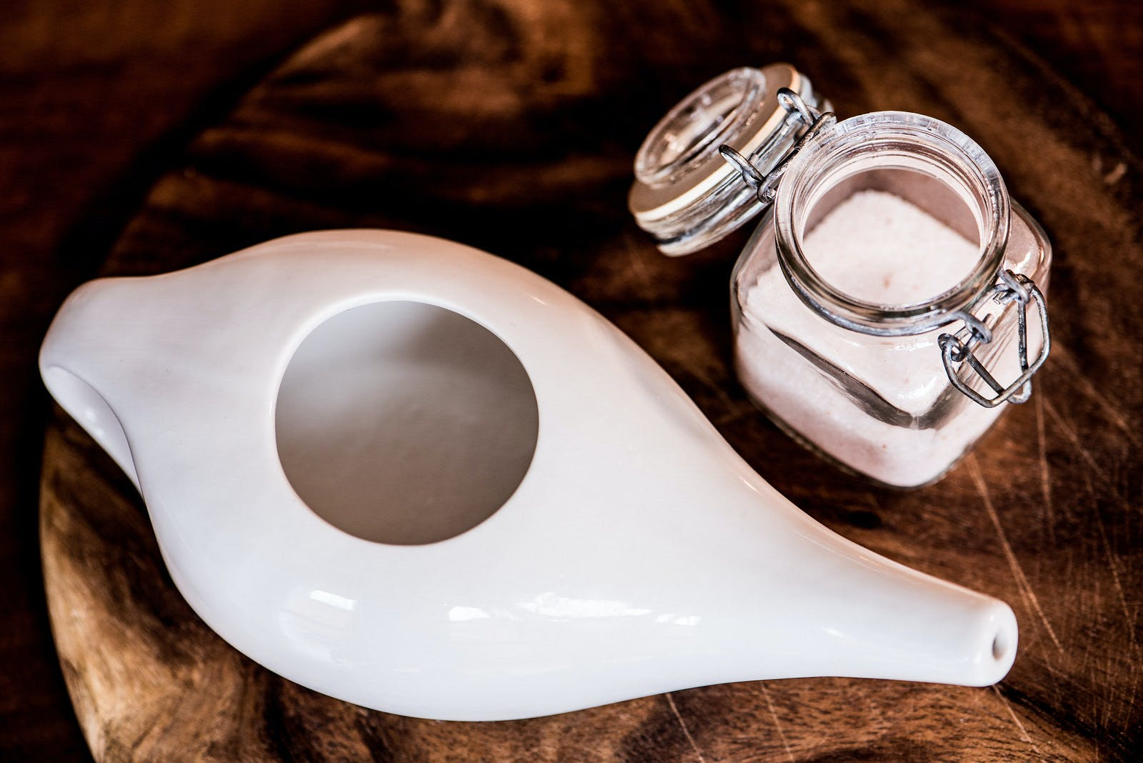 Neti pot with sterile water and salt for rinsing sinuses