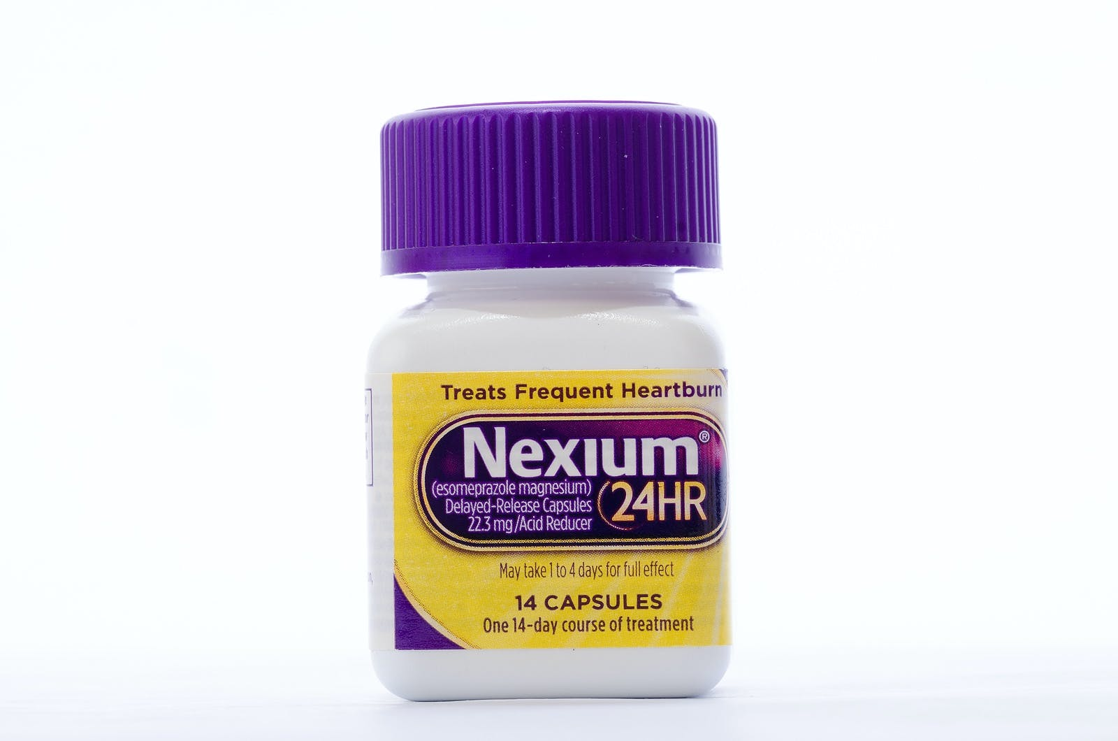 """LLANO TX-AUG 16 2015: Bottle of Nexium against white background. The """"Purple Pill"""" now sold in """"Non-Prescription"""" size dosage."""