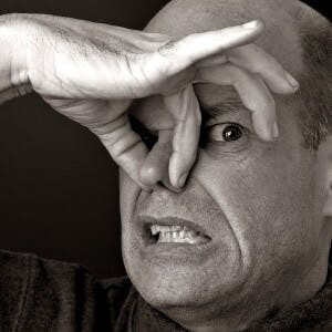 a man holding his nose because something smells