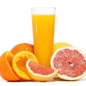 Oranges grapefruit and orange juice isolated on white background. Studio shot.