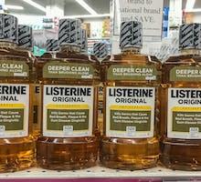 pharmacy shelf with four bottles of original amber Listerine