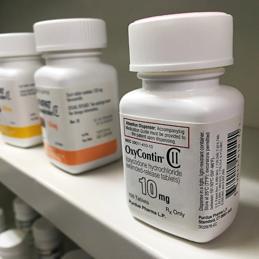 Ogden Utah- July 16, 2016: oxycontin bottle on pharmacy shelf
