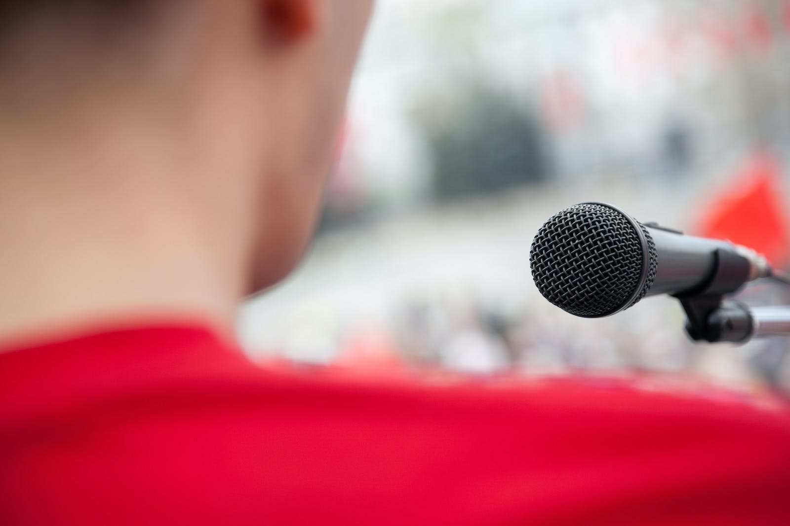microphone and shoulder of man with fear of public speaking