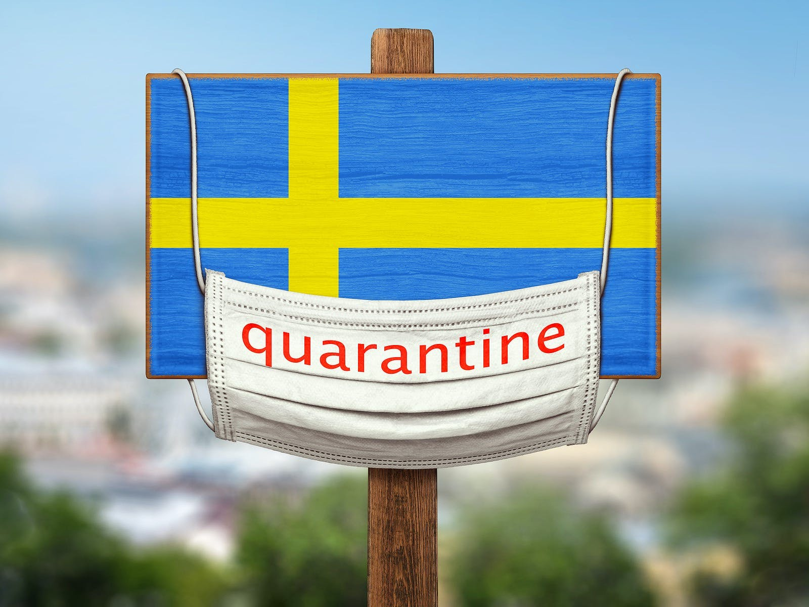 Sign on the background of the city. Quarantine during the COVID-19 coronavirus pandemic in Sweden. Medical mask with the inscription Quarantine hangs on a sign with an image of the flag of Sweden. Anti-epidemic measures.