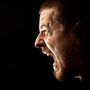 an angry man screaming about side effects of Chantix