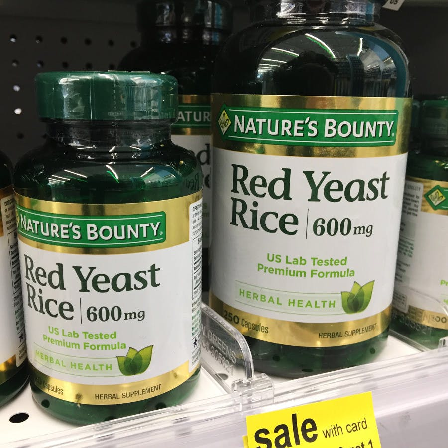Bottles of Red Yeast Rice on a store shelf