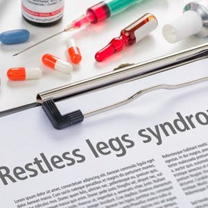 The diagnosis Restless legs syndrome written on a clipboard