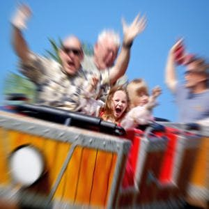 Father and Daughter On Amusement Park Roller Coaster