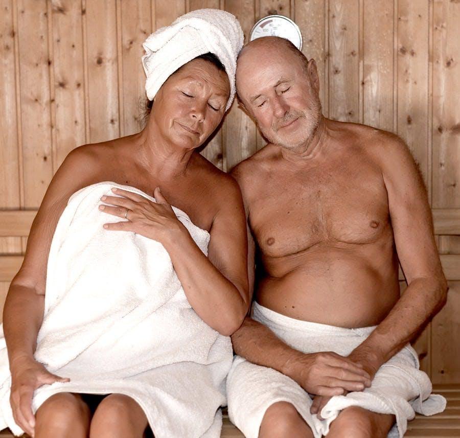 seniors couple relaxing in sauna