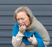 Older woman with a cough suffering from cough syrup withdrawal