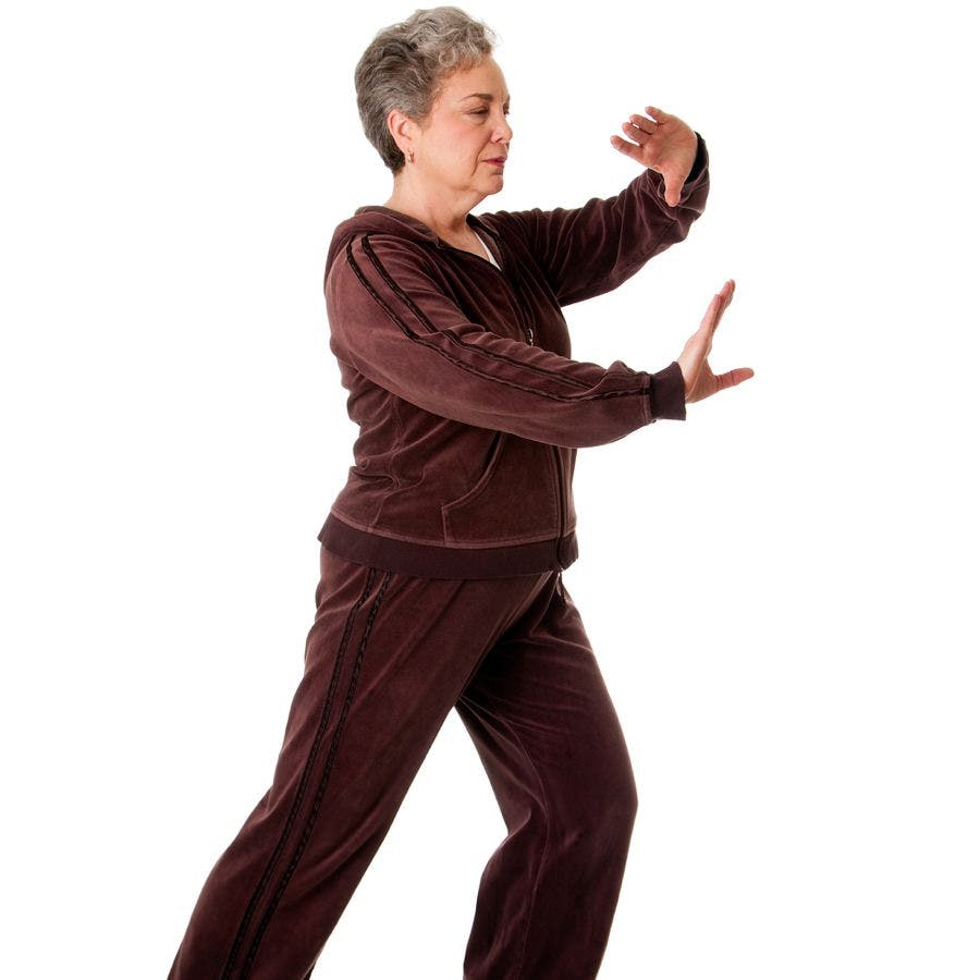 Older woman practicing tai chi to improve her balance