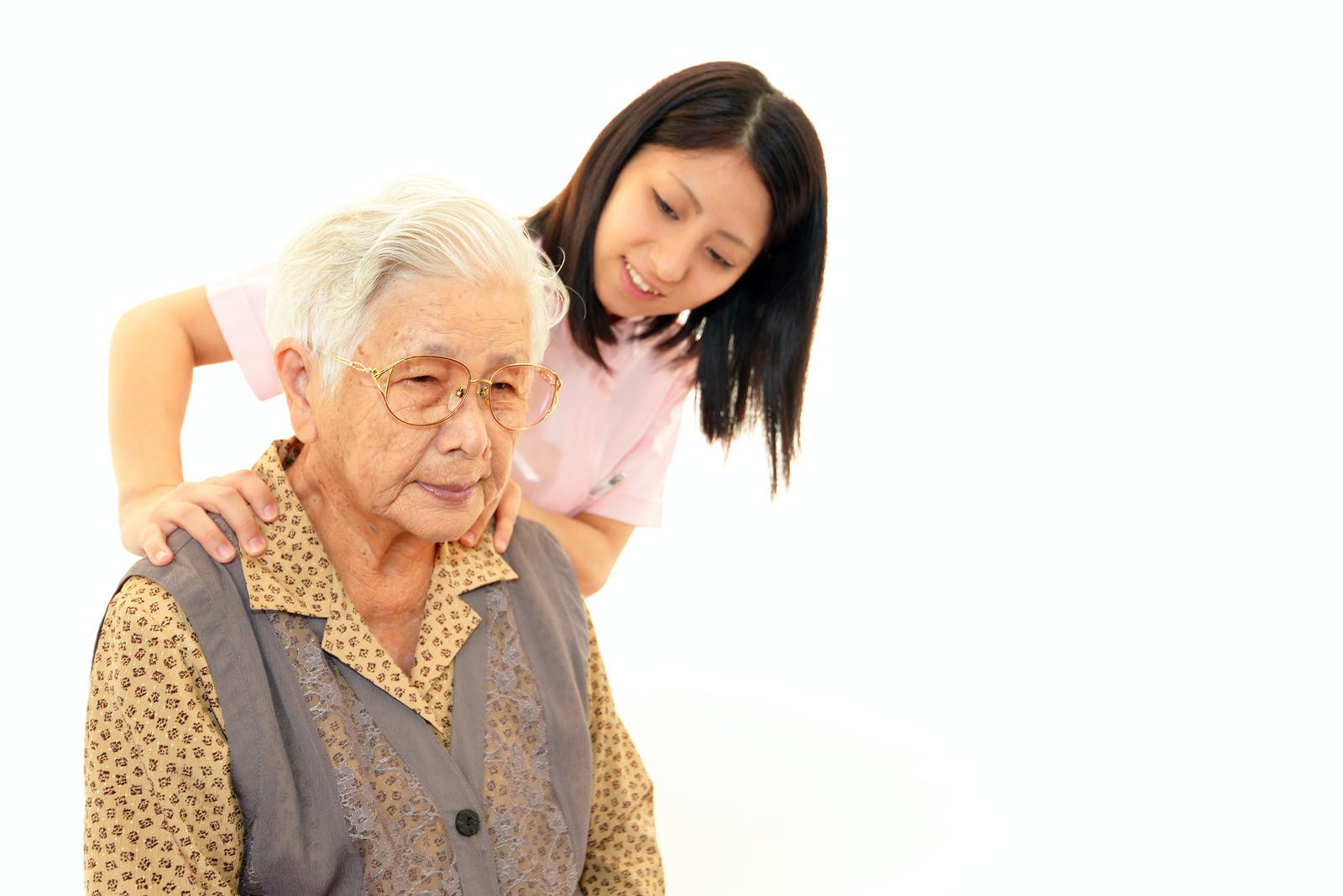 Senior woman with her home caregiver isolated on white background